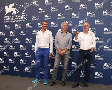 Stock Image of From left, producer Matthieu Tarot, director Christian Vincent, and actor Fabrice Luchini pose for photographers at the photo call for the film L'Hermine during the 72nd edition of the Venice Film Festival in Venice, Italy