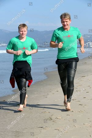 IMAGE DISTRIBUTED FOR IRONMAN - In this photo shot in Santa Monica, Calif., Celebrity chef Gordon Ramsay, right, hits the beach with son Jack Ramsay to train for the upcoming 2014 IRONMAN World Championship on Oct. 11, 2014 in Kailua-Kona, Hawaii. IRONMAN is considered the most grueling endurance race on the planet and Ramsay, an avid triathlete, is vying to beat his 2013 IRONMAN World Championship time of 14:04:48