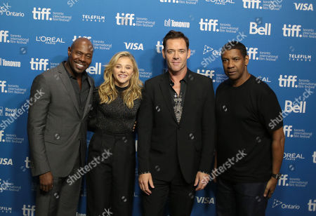 """Stock Image of Antoine Fuqua and from left, Chloe Grace Moretz, Marton Csokas and Denzel Washington attend the press conference for """"The Equalizer"""" on day 4 of the Toronto International Film Festival at the TIFF Bell Lightbox, in Toronto"""