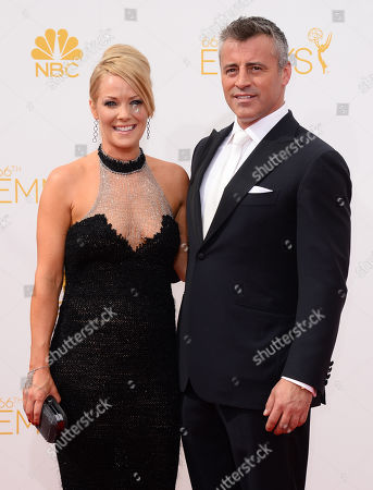 Andrea Anders, left and Matt LeBlanc arrive at the 66th Annual Primetime Emmy Awards at the Nokia Theatre L.A. Live, in Los Angeles