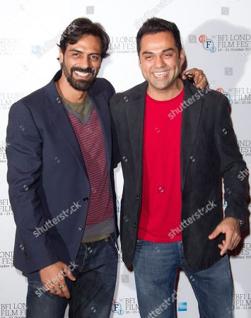 Actors Abhay Deol and Arjun Rampal, left, stand together at a photocall for Prakash Jha's 'Chakravyah' during the London Film Festival at The Empire cinema, Leicester Square on Thursday, Oct.11, 2012 in London