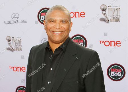 Reginald Hudlin arrives at the 45th NAACP Image Awards at the Pasadena Civic Auditorium, in Pasadena, Calif. The Academy of Motion Picture Arts and Sciences says David Hill and Hudlin will produce the 88th Oscars telecast. The Academy announced, that they'll take up the mantle from Neil Meron and Craig Zadan, who produced the show for the past three years