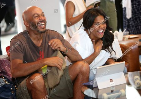 "James Lesure, left, and Nia Long crack up while live tweeting an episode of ""Uncle Buck"" at the Microsoft Lounge, in Venice, Calif"