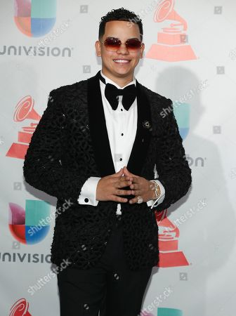 J Alvarez poses in the press room at the 18th annual Latin Grammy Awards at the MGM Grand Garden Arena, in Las Vegas