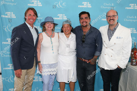 Honoree Chef John Besh, James Beard Foundation President Susan Ungaro, Chef Anita Lo, Chef Aarón Sanchez, James Beard Foundation Executive Vice and, President Mitchell Davis seen at the James Beard Foundation's Chefs & Champagne fundraiser honoring John Besh, at Wolffer Estate Vineyard in Sagaponack, N.Y