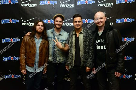 Stock Photo of Dave Welsh, Ben Wysocki, Joe King, Isaac Slade of The Fray posed backstage at the Star 94 Jingle Jam 2013 at The Arena at Gwinnett Center, in Atlanta