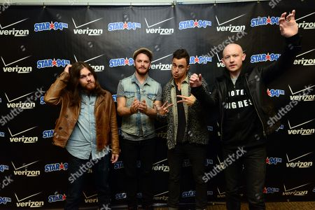 Dave Welsh, Ben Wysocki, Joe King, Isaac Slade of The Fray posed backstage at the Star 94 Jingle Jam 2013 at The Arena at Gwinnett Center, in Atlanta