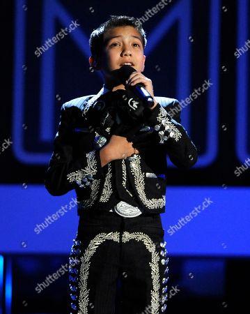 Sebastien de la Cruz sings the national anthem on stage at the NCLR ALMA Awards at the Pasadena Civic Auditorium in Pasadena, Calif