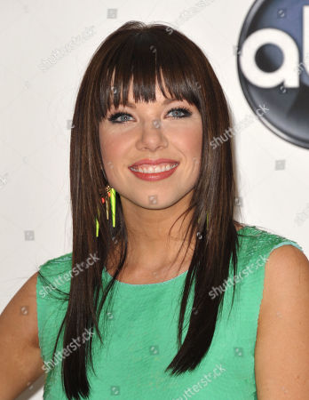 """Singer Carly Rae Jepsen poses for a photo in the media room at the 2012 Billboard Awards at the MGM Grand in Las Vegas. For those predicting that Jepsen might be headed to one-hit wonder-dom, take note _ she's already got another song climbing the charts, """"Good Time,"""" with Owl City. Still, it's her ubiquitous """"Call Me Maybe"""" that has shot her to stardom and taken the world by storm. The song has been No. 1 on Billboard's Hot 100 chart for the last five weeks, and parodies of the song from the likes of Justin Bieber and boy band Big Time Rush to James Franco and even Cookie Monster have popped up online and on late night talk shows"""