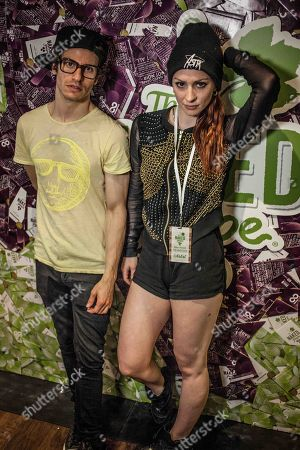 Stock Image of From left, Adam ASTR and Zoe ASTR of ASTR poses for a photo at The Naked Grape Wines Presents The Music Box at the Cedar Door during 2014 SXSW on in Austin, Texas