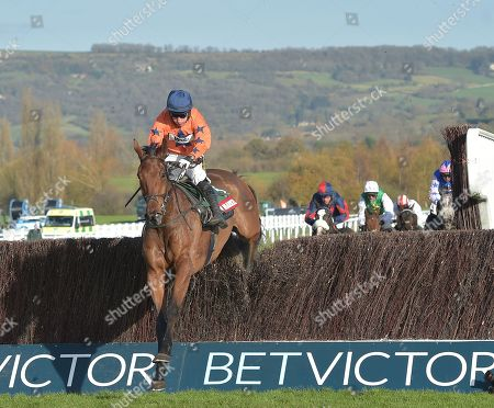 Stock Picture of What A Moment (Richard Harding) takes the last before going on to win The Markel Insurance Amateur Riders Handicap Steeple Chase.