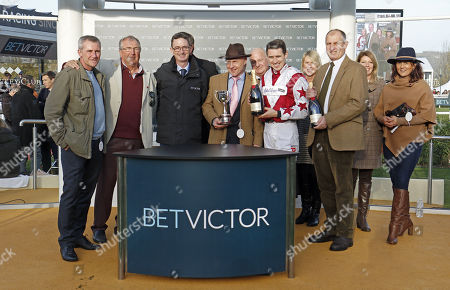 Presentation to Paddy Brennan, Paul Henderson (right) and owners for The BetVictor Handicap Chase won by DOITFORTHEVILLAGE Cheltenham