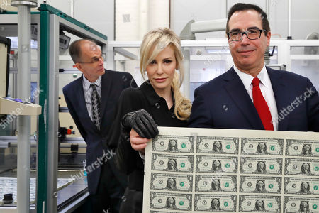 Steven Mnuchin, Louise Linton. Treasury Secretary Steven Mnuchin, right, and his wife Louise Linton, hold up a sheet of new $1 bills, the first currency notes bearing his and U.S. Treasurer Jovita Carranza's signatures, at the Bureau of Engraving and Printing in Washington. The Mnuchin-Carranza notes, which are a new series of 2017, 50-subject $1 notes, will be sent to the Federal Reserve to issue into circulation