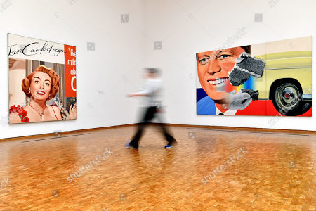 A visitor walks past the artworks 'Untitled (Joan Crawford Says...)' (L) and 'President Elect' (R) on display at the Museum Ludwig in Cologne, Germany, 17 November 2017. An exhibition titled 'James Rosenquist. Painting as Immersion' presenting a selection of artwork by the artist will open to the public from 18 November 2017 to 04 March 2018.
