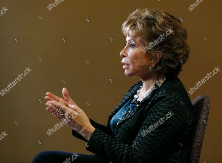 "Chilean-American author Isabel Allende poses for a photo during an interview about her book, ""Más allá del invierno,"" (In the Midst of Winter) in Miami"