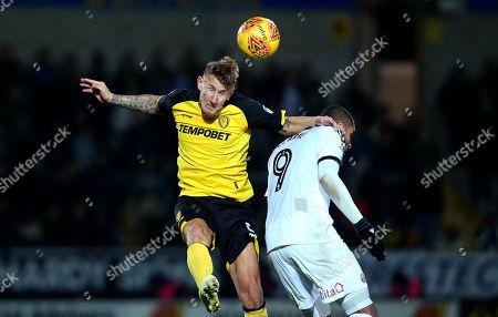 Kyle McFadzean of Burton Albion beats Leon Clarke of Sheffield United to a header