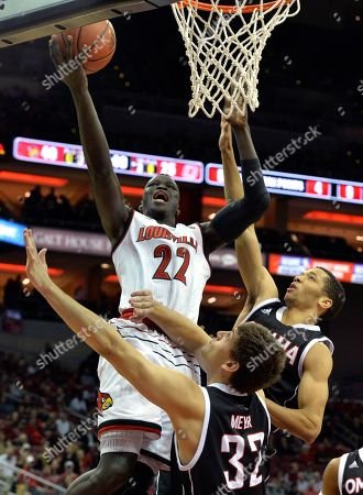 Deng Adel, Daniel Meyer, Zach Jackson. Louisville forward Deng Adel (22) attempts to shoot over the defense of Omaha forward Daniel Meyer (32) and guard Zach Jackson (21) during the second half of an NCAA college basketball game, in Louisville, Ky