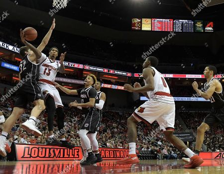 Ray Spalding, Daniel Meyer. Louisville forward Ray Spalding (13) attempts to shoot around the defense of Omaha forward Daniel Meyer (32) during the second half of an NCAA college basketball game, in Louisville, Ky