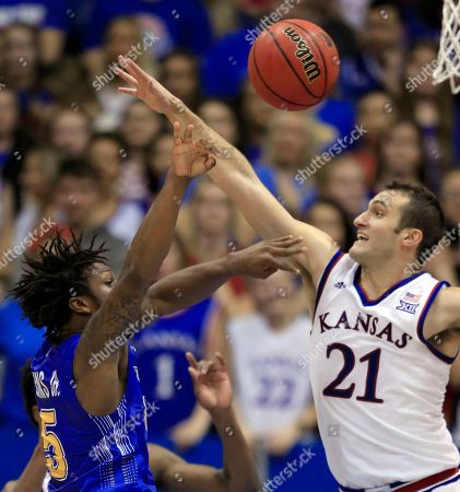 David Jenkins Jr., Clay Young. South Dakota State guard David Jenkins Jr. (5) shoots over Kansas guard Clay Young (21) during the second half of an NCAA college basketball game in Lawrence, Kan