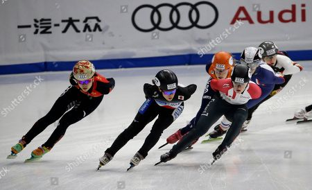 Japan's Sumire Kikuchi, second from left, leads the group during the women's 1500 meter semi-final race at the ISU World Cup Short Track Speed Skating competition in Seoul, South Korea