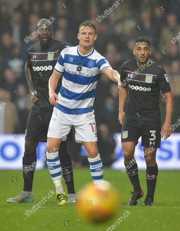 Stock Picture of Matt Smith of QPR stands between Christopher Samba and Neil Taylor of Aston Villa