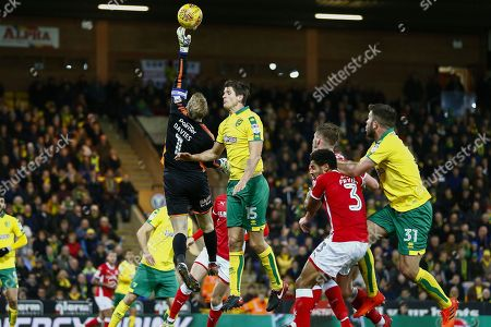 Barnsley goalkeeper Adam Davis (1) clears a corner during the EFL Sky Bet Championship match between Norwich City and Barnsley at Carrow Road, Norwich