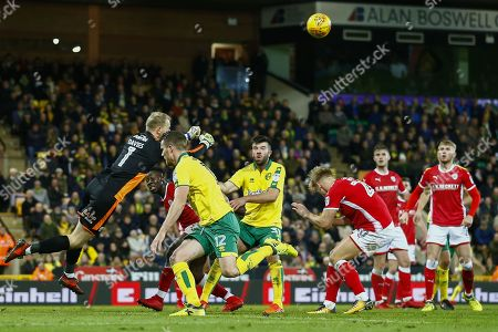 Barnsley goalkeeper Adam Davis (1) pinches the ball clear during the EFL Sky Bet Championship match between Norwich City and Barnsley at Carrow Road, Norwich