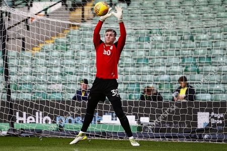 Barnsley goalkeeper Jack Walton (30) warming up ahead of the EFL Sky Bet Championship match between Norwich City and Barnsley at Carrow Road, Norwich