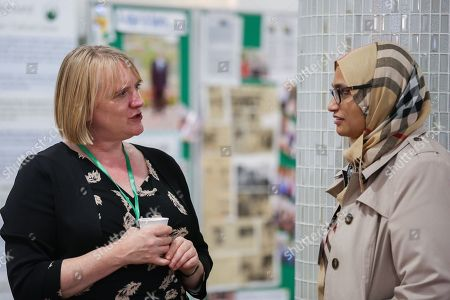 Stock Photo of Joanne McCartney AM, Deputy Mayor of London for Education and Childcare (on the left) speaking with a muslim woman at the event.