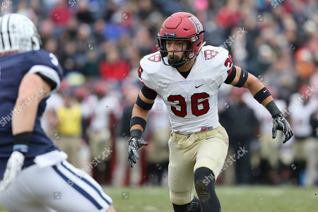 Harvard's Tanner Lee #36 in action against Yale during an NCAA college football game on in New Haven, CT. Yale won the game 24-3 and won their first outright Ivy League title since 1980