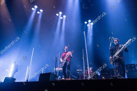 Queens Of The Stone Age performing. Josh Homme, Michael Shuman, Troy Van Leeuwen