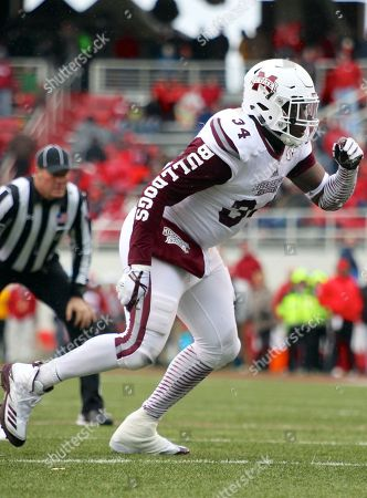 Cory Thomas #34 Mississippi State defensive tackle takes a step towards the back field. .The Mississippi State Bulldogs defeated the Arkansas Razorbacks 28-21 at Donald W. Reynolds Stadium in Fayetteville, AR, Richey Miller/CSM