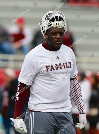 Bulldog defensive tackle Cory Thomas #34 lifts up his helmet as he warms up before the game. .The Mississippi State Bulldogs defeated the Arkansas Razorbacks 28-21 at Donald W. Reynolds Stadium in Fayetteville, AR, Richey Miller/CSM