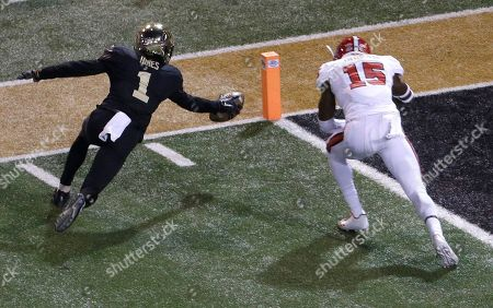 Tabari Hines, Chris Ingram. Wake Forest's Tabari Hines (1) reaches for the goal line as North Carolina State's Chris Ingram (15) defends during the first half of an NCAA college football game in Winston-Salem, N.C., . Hines scored on the play