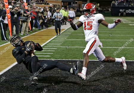 Tabari Hines, Chris Ingram. Wake Forest's Tabari Hines (1) catches a touchdown pass as North Carolina State's Chris Ingram (15) defends during the second half of an NCAA college football game in Winston-Salem, N.C