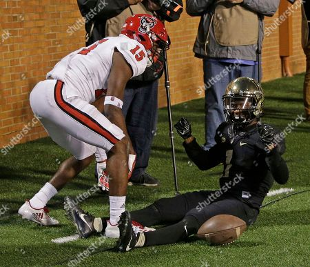 Tabari Hines, Chris Ingram. Wake Forest's Tabari Hines (1) celebrates his touchdown catch in front of North Carolina State's Chris Ingram (15) during the second half of an NCAA college football game in Winston-Salem, N.C., . Wake defeated N.C. State 30-24