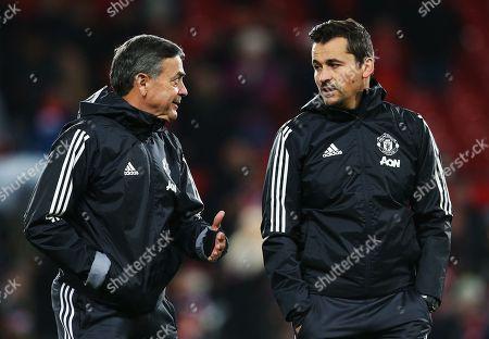 Manchester United coaches Ricardo Formosinho talks with Rui Faria