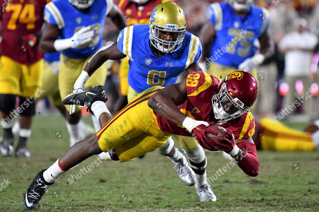 Los Angeles, CA.USC Trojans tight end Daniel Imatorbhebhe #88 catches the pass for 16 yards and the first down in action during the fourth quarter of the NCAA Football game between the USC Trojans and the UCLA Bruins at the Coliseum in Los Angeles, California..The USC Trojans defeat the UCLA Bruins 28-23.Mandatory Photo Credit : Louis Lopez/CSM