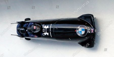 Bradley Hall, Bruce Tasker, Joel Fearon and Gregory Cackett. Driver Bradley Hall, front, Bruce Tasker, Joel Fearon and Gregory Cackett, of Britain, compete in the four-man bobsled World Cup race, in Park City, Utah