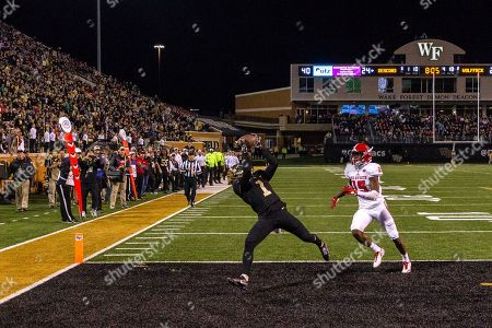 Tabari Hines (1) of the Wake Forest makes the catch for a touchdown as Chris Ingram (15) of the North Carolina State watches in the fourth quarter of the NCAA matchup between NC State and Wake Forest at BB&T Field in Winston-Salem, NC