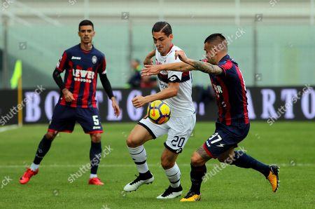 Crotone's Bruno Martella (R) and Genoa's Aleandro Rosi in action during the Italian Serie A soccer match FC Crotone vs CFC Genoa at Ezio Scida stadium in Crotone, Italy, 19 November 2017.