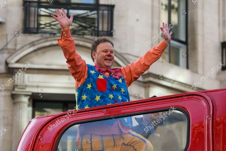 Justin Fletcher with hundreds of cast members including some of TV and film characters, take part in the annual Hamley's Toy Parade, which marches along Regent Street in London in a colourful extravaganza, with dancers, marching bands, floating blimps, street theatre and toy vehicles.