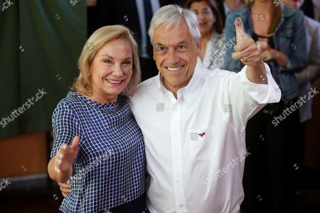 Centre-right National Renewal party's presidential candidate and former Chilean President, Sebastian Pinera, poses with his wife Cecilia Morel after casting his vote during Chile's general elections at a polling station in Santiago, Chile, 19 November 2017. With eight presidential candidates to choose from, Chileans started voting to decide who will succeed socialist leader, Michelle Bachelet, as president.