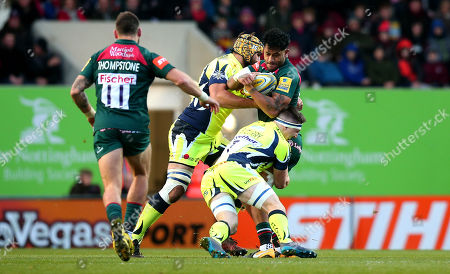 Valentino Mapapalangi of Leicester Tigers is tackled