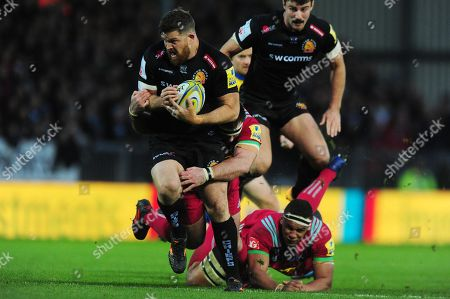 Moray Low of Exeter Chiefs breaks through the tackle of Ben Glynn of Harlequins during the Aviva Premiership match between Exeter Chiefs and Harlequins at Sandy Park on November 19th 2017 , Exeter, Devon (