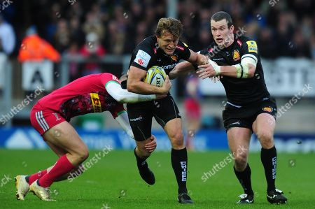 Lachie Turner of Exeter Chiefs is tackled by Harry Sloan of Harlequins during the Aviva Premiership match between Exeter Chiefs and Harlequins at Sandy Park on November 19th 2017 , Exeter, Devon (