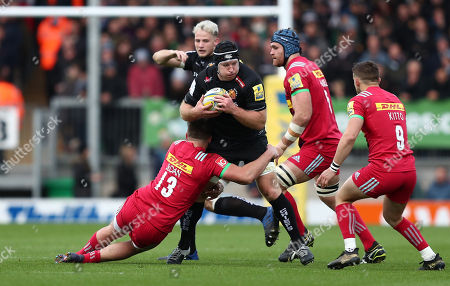 Thomas Waldrom of Exeter Chiefs is tackled by Harry Sloan of Harlequins