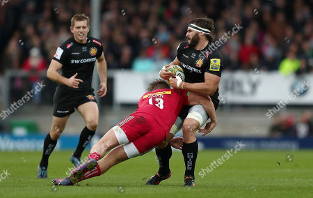 Don Armand of Exeter Chiefs is tackled by Harry Sloan of Harlequins