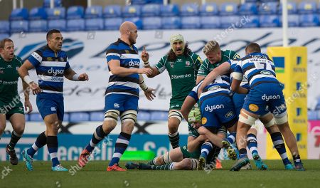 Franco van der Merwe of London Irish and Conor Gilsenan of London Irish hold on to Tom Dunn of Bath Rugby in the tackle during the Aviva Premiership Rugby match between London Irish and Bath Rugby at Madejski Stadium on November 19th 2017 in Reading, Berkshire, England. (Photo by Gareth Davies/PPAUK)