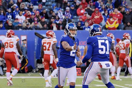New York Giants kicker Aldrick Rosas (2) celebrates a field goal with teammate Zak DeOssie (51) during the second half of an NFL football game, in East Rutherford, N.J. The Giants won 12-9 in overtime